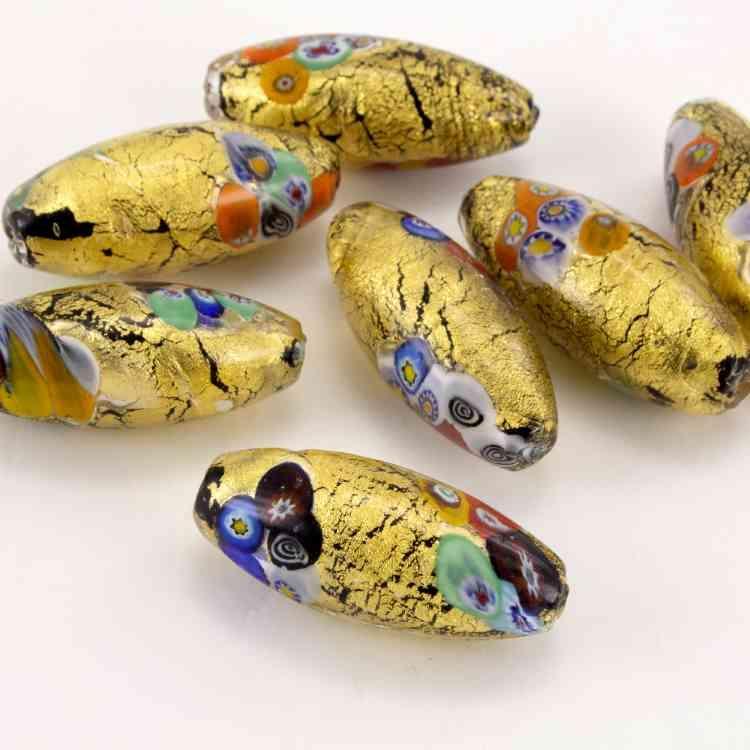 Perla vetro di Murano ovale 45 mm. Foglia oro con murrine multicolor. Foro passante.