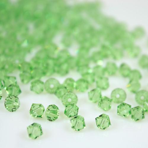 Perla bicono Peridot 4 mm cristallo Swarovski 5328 bead