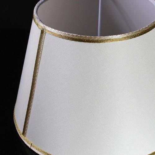 Paralume tronco cono in cotonette avorio, con passamaneria crema e oro, interno in PVC bianco, dimensione Ø inf. 25 cm, Ø sup. 16 cm, h 17 cm, attacco E14 bianco.