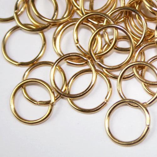 Anello Ø7 mm in bagno oro per catene di cristalli, perle e vetri.