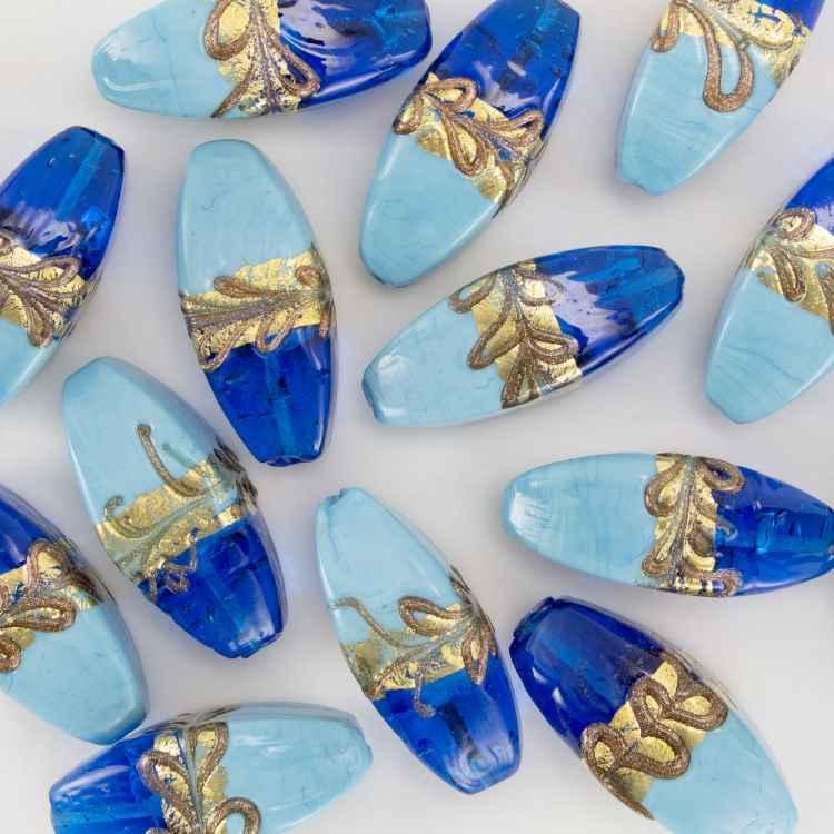 Perla di Murano a oliva 42 mm con fascia oro e bronzo, vetro blue e celeste con foro passante.