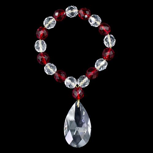 Anello portatovagliolo con perle in cristallo strass trasparente e rosso Ø10 mm con ciondolo mandorla 38 mm.