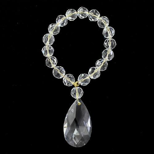 Anello portatovagliolo con perle in cristallo strass trasparente Ø8 mm e ciondolo mandorla 38 mm.