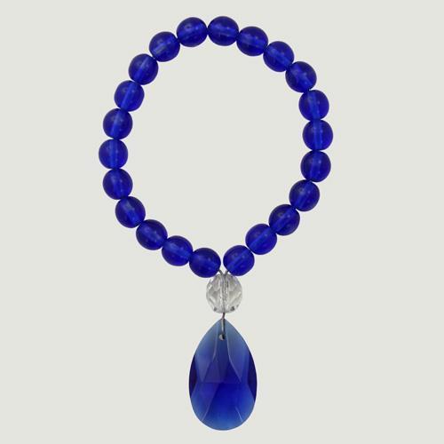 Anello portatovagliolo con perle in vetro di murano color blu Ø8 mm e ciondolo cristallo blu 28 mm.
