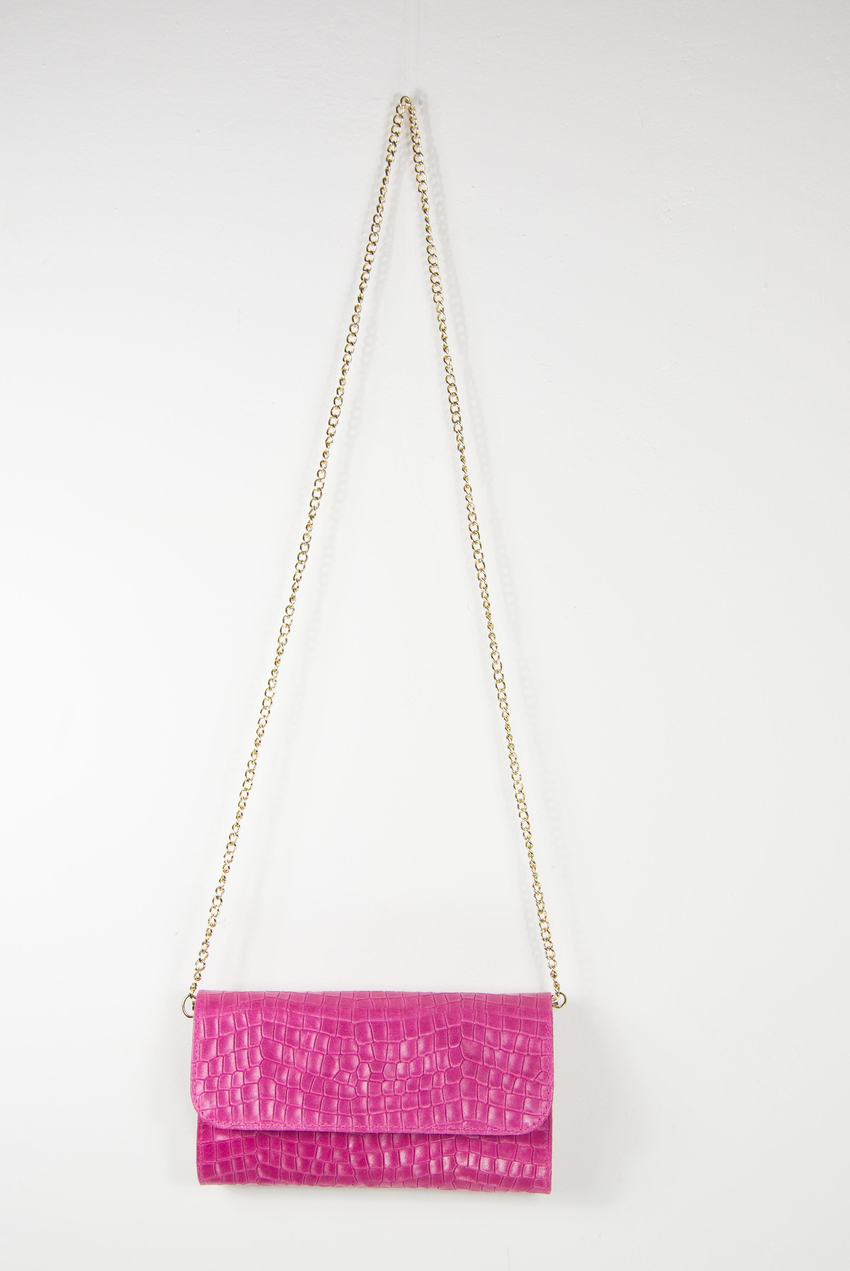Fuchsia clutch bag in worked leather. Online bags