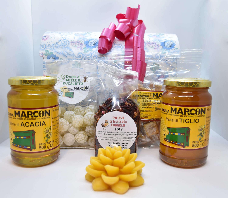 Confezione regalo con miele, caramelle e candela in cera d'api