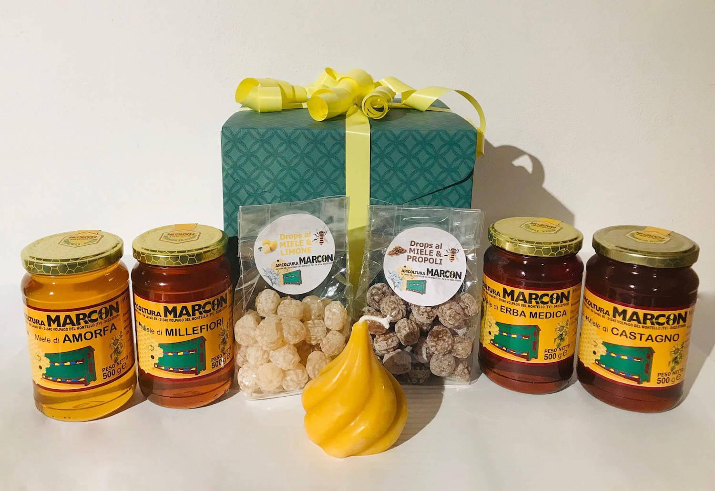 Confezione regalo con miele, caramelle drop e candela in cera d'api