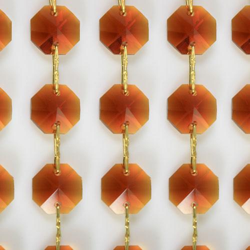 Catena ottagoni 20 mm in cristallo colore ambra, lunghezza 50 cm, clip ottone.