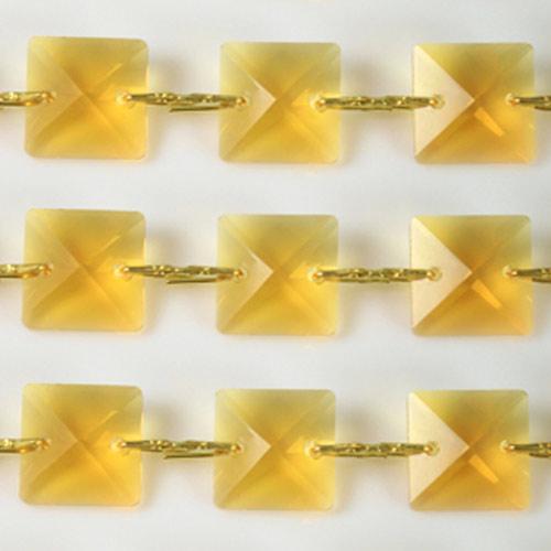 Catena quadrucci cristallo 22 mm - lunghezza 50 cm. Colore giallo - clip ottone.