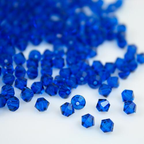 Perla bicono Capri Blue 4 mm cristallo Swarovski 5328 bead